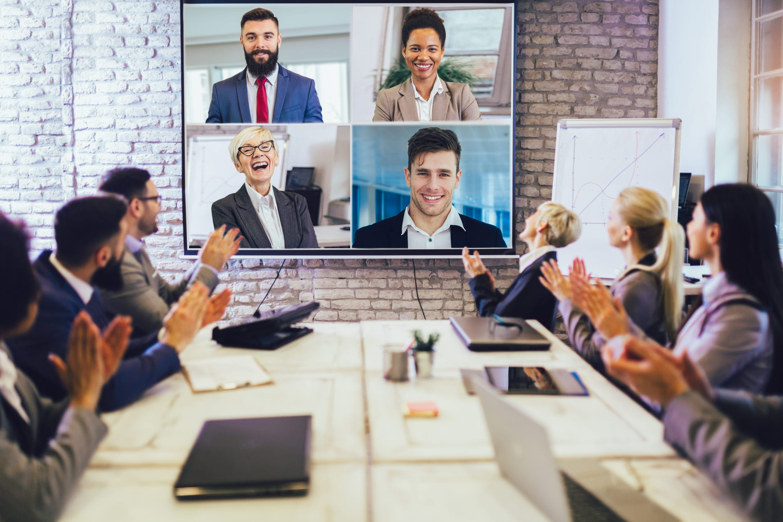 Business people looking at an audio & visual system during a video conference in the conference room