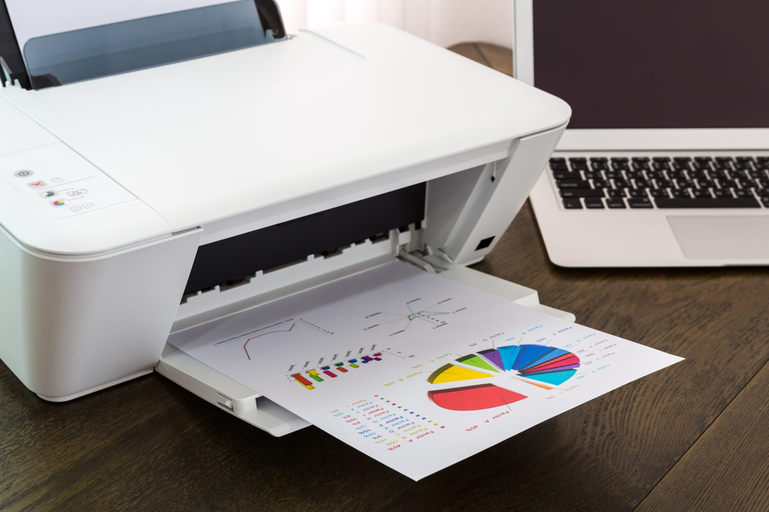 A Printers ability to print out colors is shown with a freshly printed color paper on the printer tray.